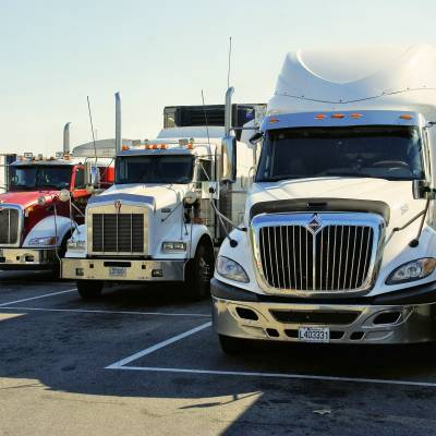 TIPS FOR DRIVING SAFELY WITH LARGE TRUCKS ON THE ROAD